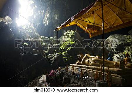 Stock Photography of Religious statue in rocky cave, Luang Prabang.
