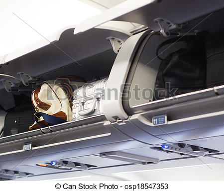 Stock Images of Hand luggage compartments on a jet plane.