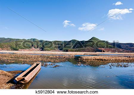 Stock Photo of boat in lugu lake k5912804.