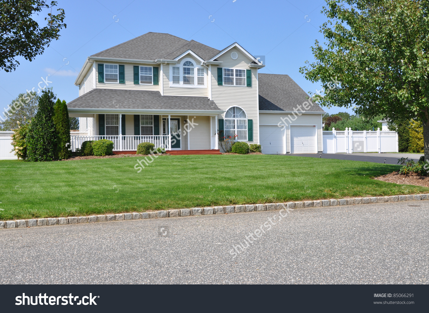 Suburban Two Story Double Garage Luxury Home Sunny Day Residential.