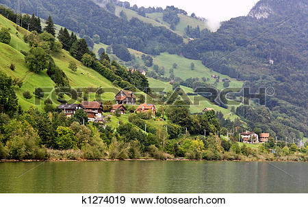 Stock Photograph of The small village on the hills around Lake.