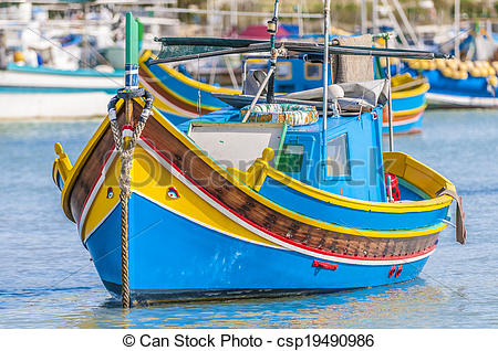 Pictures of Traditional Luzzu boat at Marsaxlokk harbor in Malta.