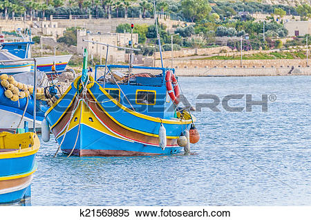 Stock Image of Traditional Luzzu boat at Marsaxlokk harbor in.