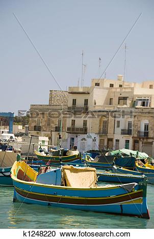Stock Photography of luzzu boats in marsaxlokk malta fishing.