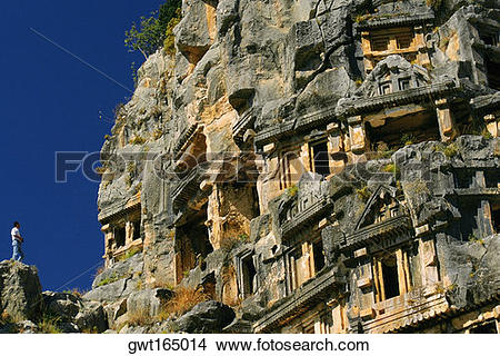 Stock Photo of Low angle view of caves on rocks, Lycian Rock Tomb.