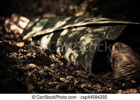 Stock Photographs of Dead body of a teenage boy lying in a forest.