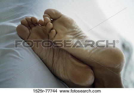 Stock Photo of relaxation, body parts, crossed, long, barefoot.