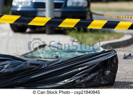 Stock Photo of Dead body in a plastic bag lying on the street.
