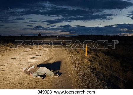 Stock Photo of Body lying in road 349023.