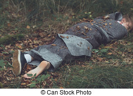 Stock Photography of Corpse of murder victim lying in forest.