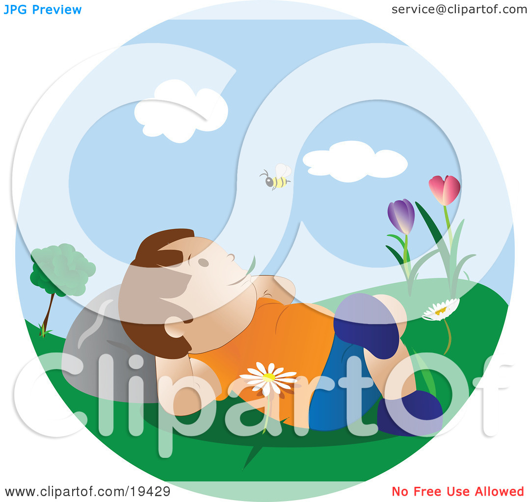 Boy lying on the grass clipart.