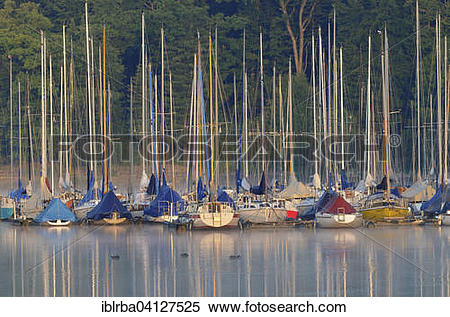 Stock Image of Sailboats, moored, in the morning light, Mohne.