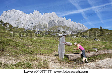 """Picture of """"Hiker drinking at a fountain, alpine landscape."""
