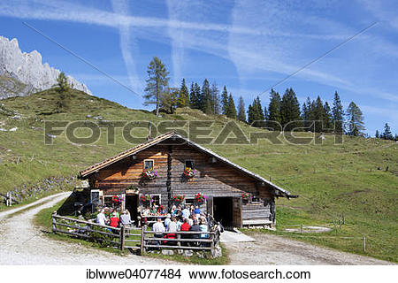 """Stock Photo of """"Mountain hut with Hochkonig, resting hikers."""