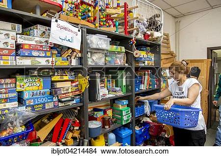 Stock Photo of Warehouse for refugees with toys, Volunteer.