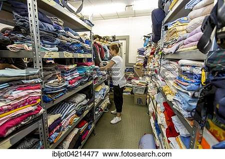 Picture of Warehouse with clothing for refugees, Volunteers.
