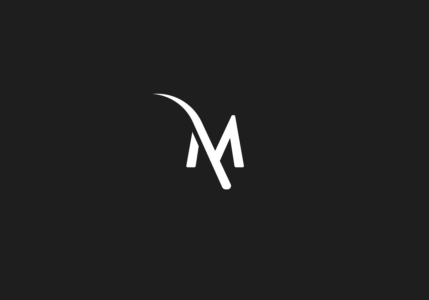 THE M logo design on Behance.