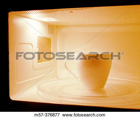 Picture of One white coffee mug inside a microwave m57.