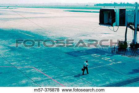 Pictures of One person on a runway of an airport walking and.