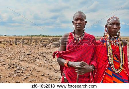 Pictures of Kenya Africa Amboseli Masai man and woman in red.
