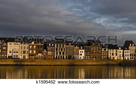 Stock Photo of Maastricht Houses at Sunset k1595452.