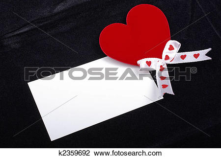 Clip Art of Red heart and white card macro isolated on black.