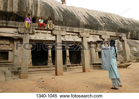 Stock Image of Girl taking a picture of her friends at a temple.