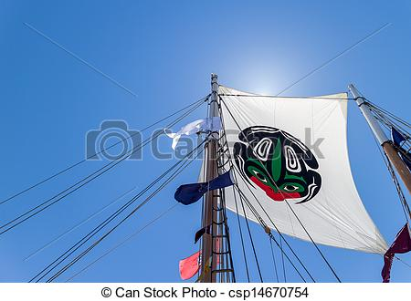 Stock Images of main mast flag flying in the sun.