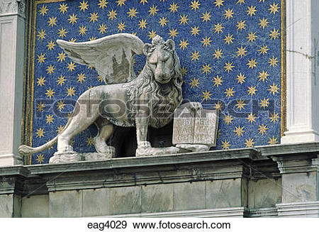 Stock Photograph of A stone LION WITH WINGS sits above the.