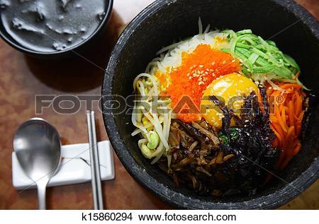 Stock Photo of Korean cuisine : bibimbap in a heated stone bowl.
