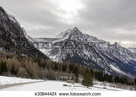 Stock Photo of Albigna dam and Maloja pass road, Switzerland.