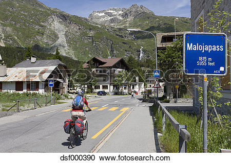 Stock Photography of Switzerland, Mature man cycling on road.