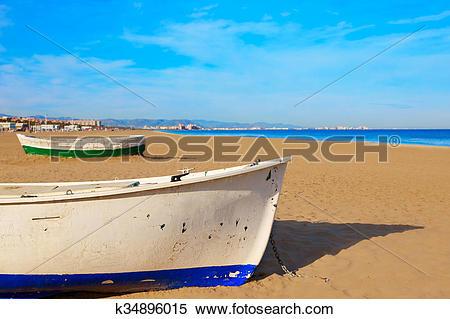 Stock Image of Valencia La Malvarrosa beach boats stranded.