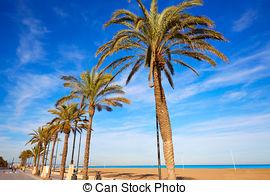 Stock Photos of Valencia La Malvarrosa beach palm trees Spain.