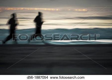 Stock Photo of runners on the beach, Malvarrosa beach, Valencia.