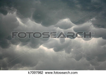 Stock Photo of Heavy rain clouds Mammatus, also known as.