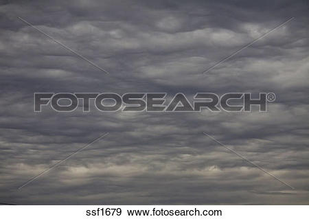 Stock Photograph of Threatening Mammatus type clouds forming.