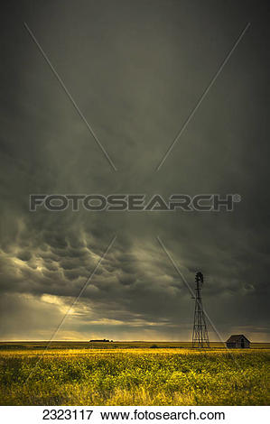 Picture of Mammatus storm clouds above a windmill on the.