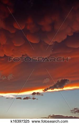Stock Image of Mammatus clouds at sunset ahead of violent.