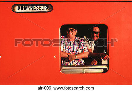 Stock Images of Man and Woman Looking out of a Train Window afr.