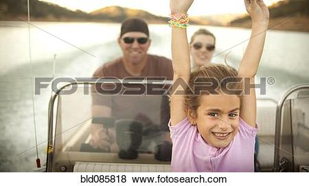 Pictures of Girl and parents enjoying riding on boat bld085818.