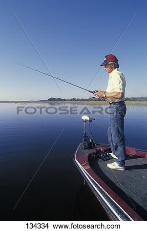 Stock Photo of Man Bass Fishing Using Bass Boat 134334.