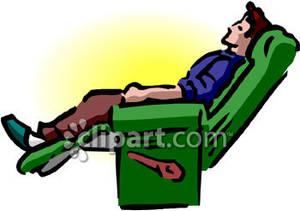 A Man Reclining In a Chair.
