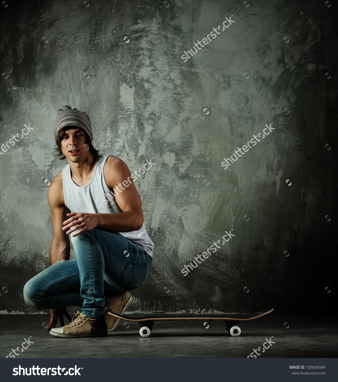 Man sitting on skateboard clipart.