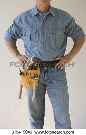 Stock Image of Man wearing tool belt u15419045.