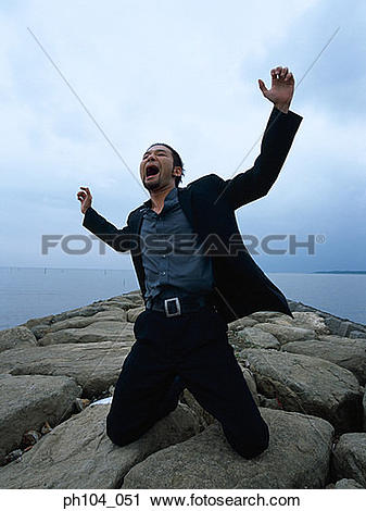 Stock Photography of Man kneeling, arms raised, shouting ph104_051.