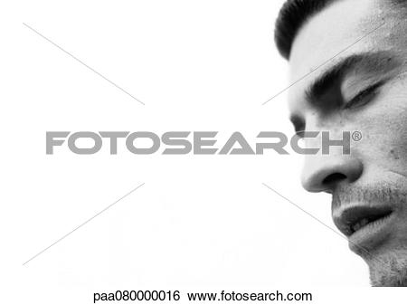 Stock Images of Man's face with eyes closed and mouth open, close.