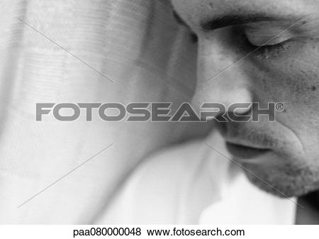 Pictures of Man's face, eyes closed, close.