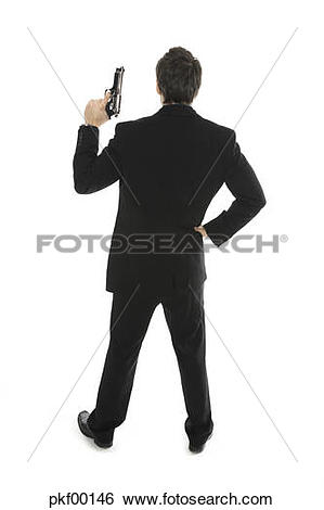 Stock Images of Young man holding hand gun, close.