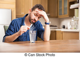 Stock Photo of man putting an effervescent tablet into a glass.